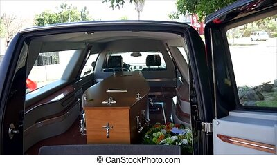 closeup shot of a funeral casket in a hearse or chapel or...