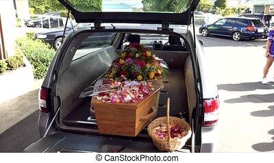 closeup shot of a funeral casket in a hearse
