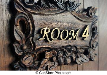 Closeup shot of a hostel door Room Number 4
