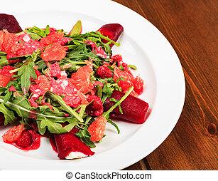 Closeup shot of a plate full of a salad