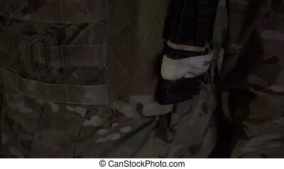 Closeup shot of a soldier with USA flag tab on a bulletproof...