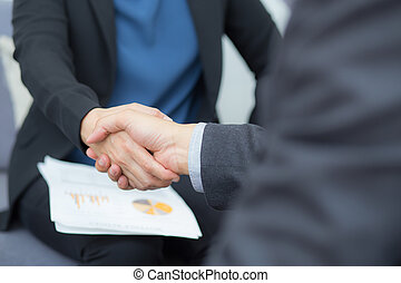 Closeup shot of a two business people shaking hands - Handshake Greeting Deal Concept
