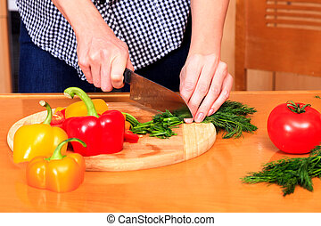 Closeup shot of a woman preparing a salad