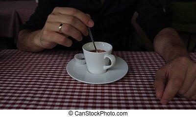 Closeup shot of an unrecognizable man preparing a cup of...