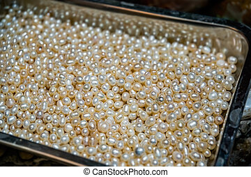 Closeup shot of bright golden colored beads pile