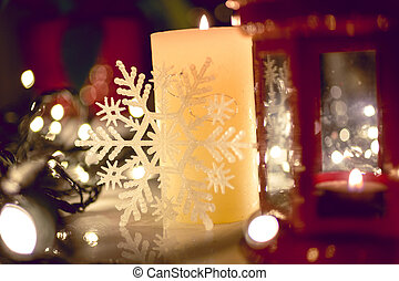 Closeup shot of burning candle on decorated Christmas table