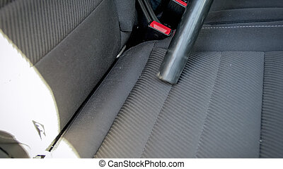 Closeup shot of car back seat cleaned with vacuum cleaner