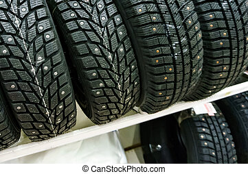 Closeup shot of car tyres on a shelf