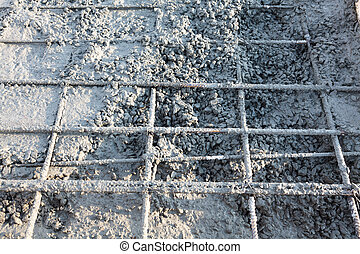 Closeup shot of construction site reinforcing metal bars of industrial floor
