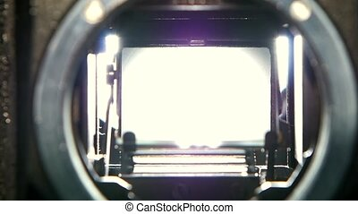 Closeup shot of diaphragm camera shutter blade in slow motion