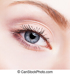 female face makeup with blue eye