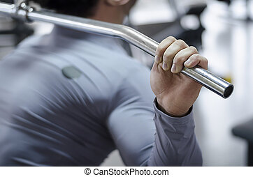 Closeup shot of male hand holding pulldown machine handle, workout in the gym
