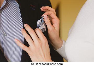 closeup shot of newlyweds hands. Wedding background.