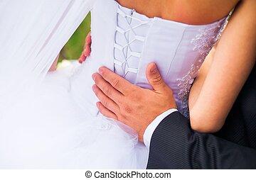 closeup shot of newlyweds hands