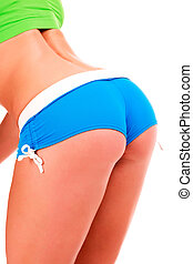 Closeup shot of sexy young fitness woman in blue shorts