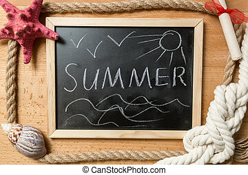 """summer"" written on blackboard with frame of ropes, seashells an"