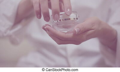 Closeup shot of tender woman hands opening and closing glass...