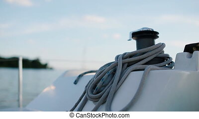 Closeup shot of the rope on the belaying cleat yacht -...