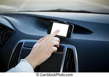 Closeup shot of woman using GPS navigator at car