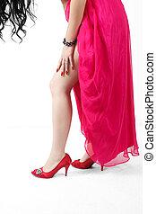 Closeup shot of young woman's legs in fashionable high heel