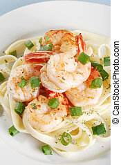 shrimp and noodles on a plate