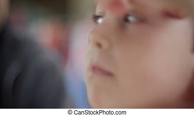 Closeup side view of an innocent young boys face - slowmo shallow depth