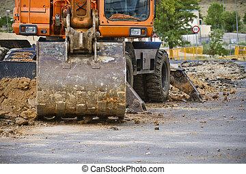 Closeup skid steer loader excavator at road construction...