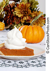 slice pumpkin pie with lots of whip