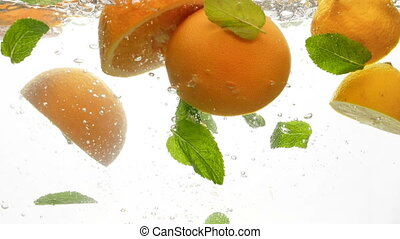 Closeup slow motion footage of juicy and ripe citrus fruits...