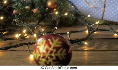 Closeup slow motion footage of red Christmas bauble falling...