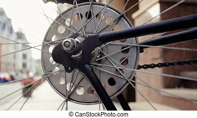 Closeup slow motion footage of rotating bicycle wheel on...