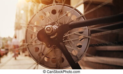 Closeup slow motion footage of spinning vintage bicycle...