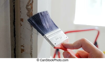 Closeup slow motion footage of young woman painting old...