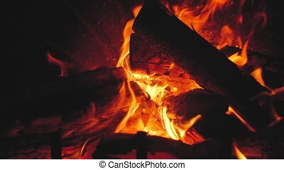 Closeup slow motion video of burning fire in the traditional...