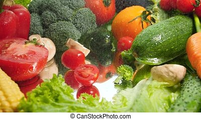 Closeup slow motion video of cut vegetable falling on wet ...