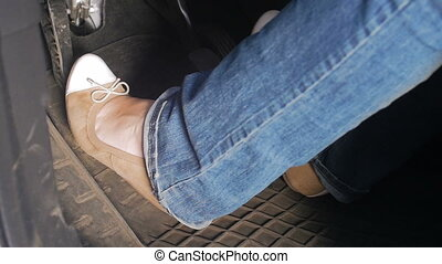 Closeup slow motion video of female drivers feet in...