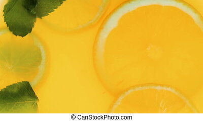 Closeup slow motion video of orange slices and mint leaves...