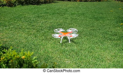 Closeup slow motion video of small toy drone taking off the...