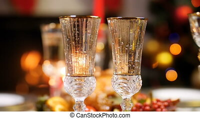 Closeup slow motion video of two empty glasses of champagne ...