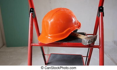 Closeup slow motion video of working tools and red helmet...