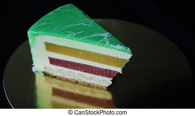 closeup small piece of glazed green cake - closeup panorama...