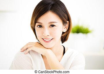 closeup smiling young asian woman face