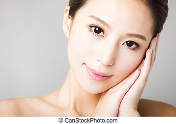 closeup smiling young  beautiful  woman face
