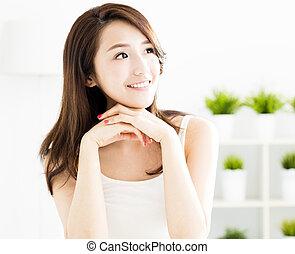 closeup smiling young  woman face