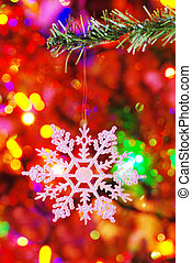 snowflake on a fake spruce branch