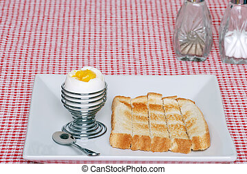 soft boiled egg with sliced toast