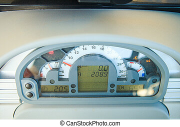 speedometer on instrument panel in tractor cabin