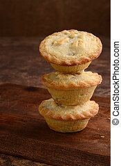 closeup stack of christmas mincemeat pies