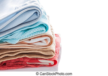 Closeup stack of female underwear on the white.