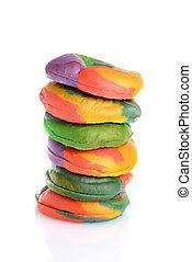 closeup stack of rainbow bagels